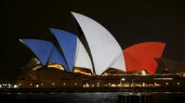 The blue, white and red colours of France's national flag are projected onto the sails of Sydney's Opera House in Australia, 14 November 2015