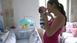 Mila holding Gabriel