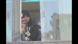 A family leaving Eastern Aleppo