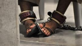 Guantanamo detainee's feet shackled to the floor