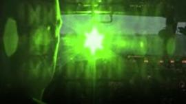 simulation of a pilot being shone with a laser