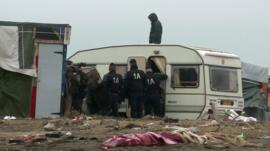 Riot police in Calais migrant camp the 'Jungle'