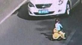 Toddler on toy car