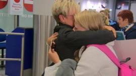A mother hugs her daughter in Bristol Airport on her return from Sharm el-Sheikh