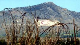 Turkish flags on mountain seen from Green Line