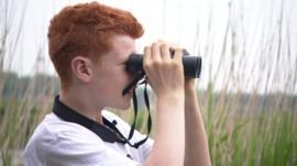 Finn with binoculars