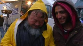 Ai Weiwei (left) with Syrian migrant Husan Jakal