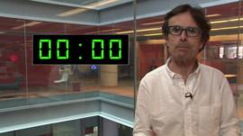 Robert Peston stands in front of a superimposed digital countdown showing zero