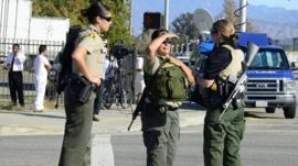 Heavily armed police at the Inland Regional Center in San Bernardino