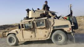 Afghan security forces on top of a vehicle outside Kunduz city on 1 October 2015