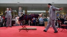 Penn & Teller perform a levitation illusion