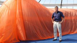 Andy Green stands next to Bloodhound model