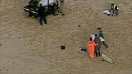 Emergency services on the beach following the shark attack