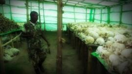 Soldier looking at skulls