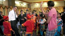 President Barack Obama and First Lady Michelle dance with Indian children
