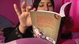 Meena Bint Mohammed with her novel