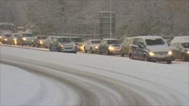 Traffic queued in snow
