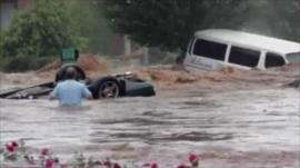 Car and van swept away by floods