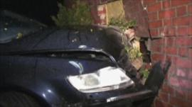 The car crashed into the living room of the house