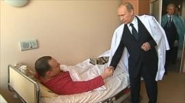 PM Putin meets an injured man in hospital