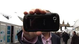 Rory Cellan Jones thrusting a mobile phone into camera lens