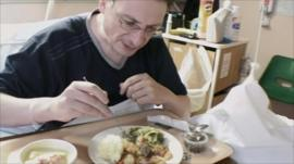 Mark Sparrow eating hospital food