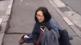 A woman gets to the ground as the quake strikes