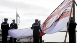 HMS Ark Royal's flag being lowered for the last time