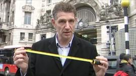 BBC reporter Nick Lawrence with tape measure