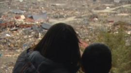 Rikuzentakata residents look at wreckage