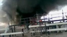 Screen grab from amateur footage that appears to show an oil field on fire