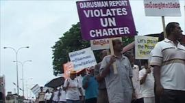 Protesters in Sri Lanka carrying anti-UN placards