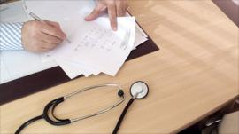 Doctor writes notes