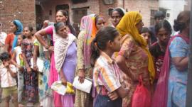 Women queue up to buy subsidised food