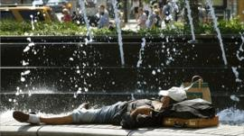 A man in New York cools down during the heat-wave