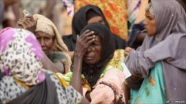 Women waiting for aid