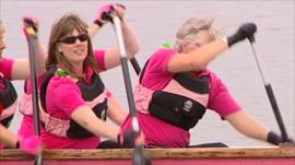 Cancer patients paddle a boat