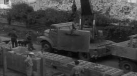 German officials supervise construction of the Berlin Wall