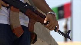 Gun and Libyan flag