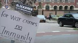 Placard saying 'for war crimes no immunity'