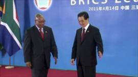 South African president Jacob Zuma is greeted by Chinese President Hu Jintao