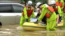 Rescuers help evacuate people