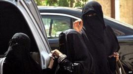 Saudi women in Riyadh stand by a car