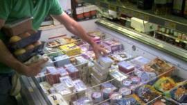 Shop's freezer unit full of food