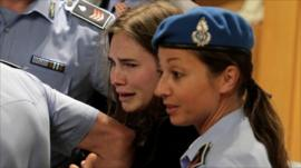 Amanda Knox weeps as an Italian court uphold her appeal