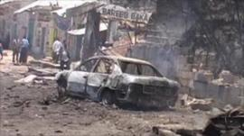 Shell of a car burnt out by the blast