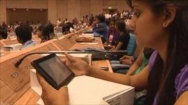 A student holds India's news tablet computer