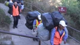 Rubbish collectors at the Great Wall of China