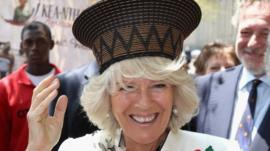 Camilla tries on hat