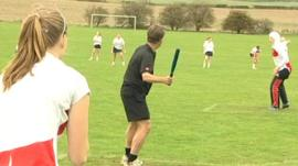 The BBC's Mike Bushell playing rounders in Dinnington